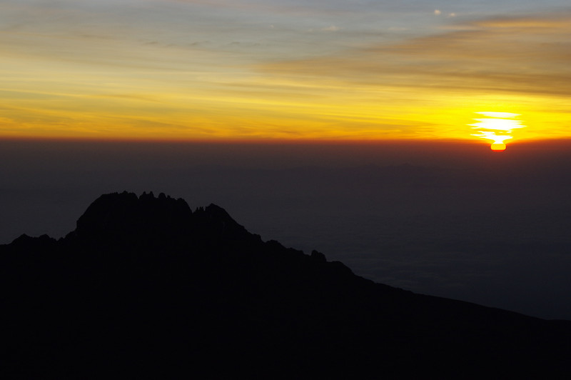 "First light of the New Year/Sunrise at Mawenzi Peak<br /> For the german report check out: <a href=""http://blog.tapir-store.de/planet-erde-reiseberichte/23966.silvester-auf-dem-kilimanjaro.html"">http://blog.tapir-store.de/planet-erde-reiseberichte/23966.silvester-auf-dem-kilimanjaro.html</a>"