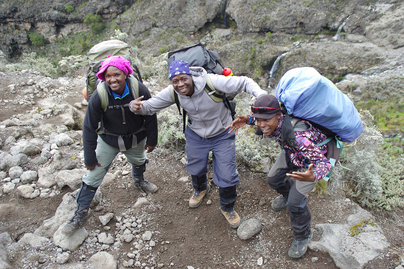 My Chiefguides Frankie and Wilson (left) + Waziri (Weeze!!!) a young fellow who might become the first person that runs to the summit of Mount Kilimanjaro and back to town in less than 30 minutes