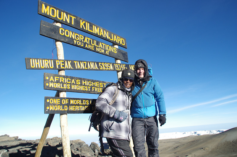 Made it! At the top of Uhuru Peak with one of my best mountain guides Donovan!