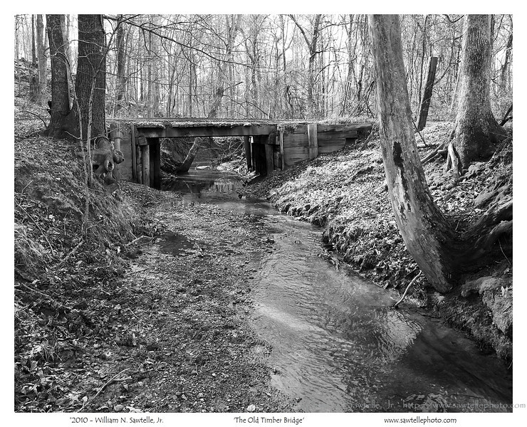 The Old Timber Bridge (Tipton County) - this bridge was damaged by a large storm in May 2010, and has been replaced by a corrugated metal pipe culvert. I remember the county rebuilding this timber bridge in the 1960's. It is somewhat sad seeing another piece of nostalgia go away.