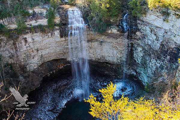 Fall Creek Falls Base:  Fall Creek Falls: A paradise of more than 20,000 acres sprawled across the eastern top of the rugged Cumberland Plateau, Fall Creek Falls State Park is one of the most scenic and spectacular outdoor recreation areas in America. Laced with cascades, gorges, waterfalls, streams, and lush stands of virgin hardwood timber, the park beckons those who enjoy nature at her finest. While Fall Creek Falls, at 256 feet, is the highest waterfall in the eastern United States, other waterfalls in the park are Piney and Cane Creek Falls and Cane Creek Cascades.  A trail leads from the parking lot atop the plateau down to the base of the gorge, giving access to the waterfall's plungepool.  The Tennessee Park service has provided an excellent wood rail fence along what some would call a strenuous decent to the base of this fall. There are a lot of large rocks on this trail that form a natural stairway.  Directions:  From Nashville take I-40 East to Cookeville (82 miles). Turn right onto 111 South (exit 288). Park entrance is on the left on Highway 284 (40 miles from I-40 to the park).