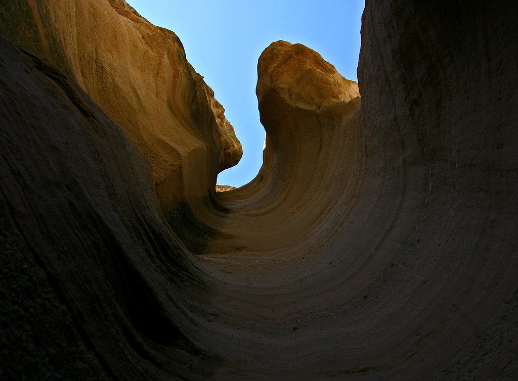 Curves in pumice rock carved by water. Kasha-Katuwe Tent Rocks National Monument.