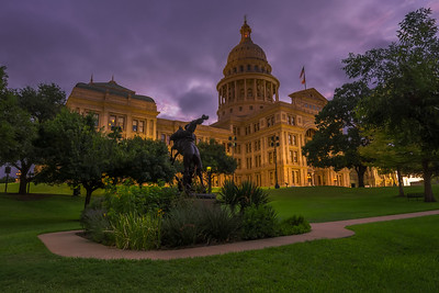 Texas Cowboy Monument with Purple clouds.