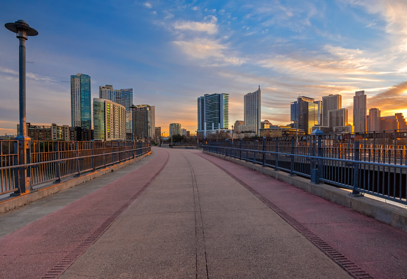 Austin skyline at sunrise from Pfluger Pedestrian bridge.