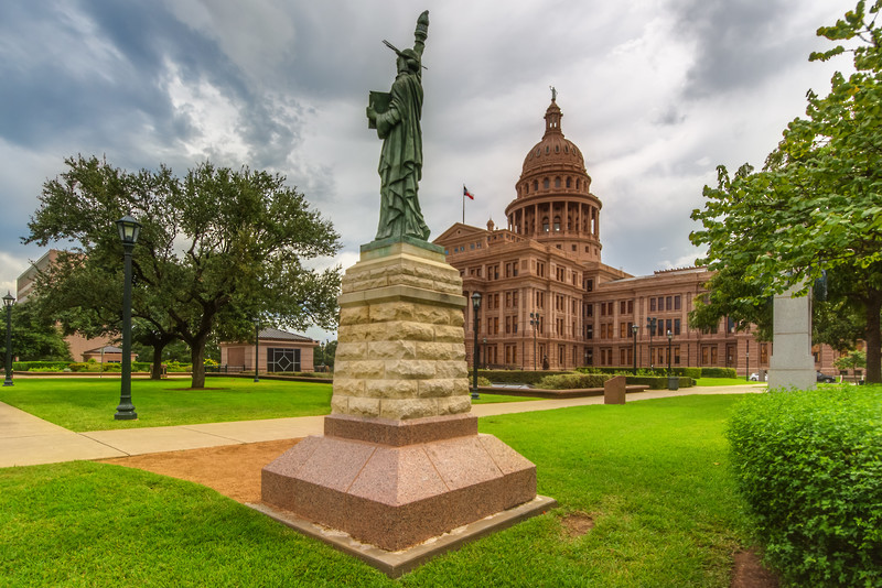 Statue of Liberty Replica Monument with Texas State Capitol.