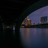 Lamar Boulevard Bridge with Austin skyline at blue hour.