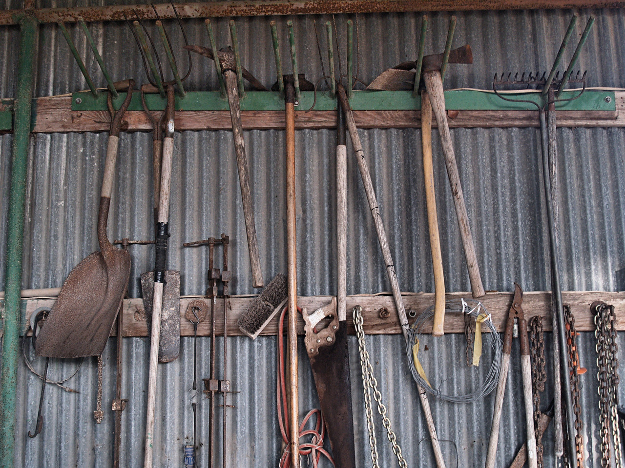 OLYMPUS DIGITAL CAMERA--Ranch tools hanging in the shed.