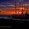 """Mayport Sunset""  The sun sets beyond the shrimp boats moored on the St. Johns River in Mayport, Florida."