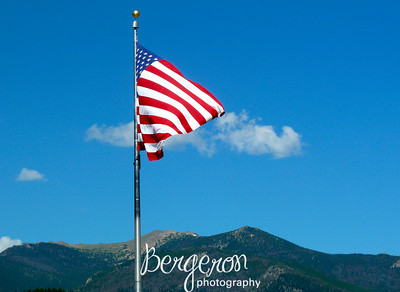 American Flag with Rocky Mountains in the background