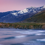 Big Sur's Cone Peak covered in snow on the Pacific Ocean.  California Central Coast