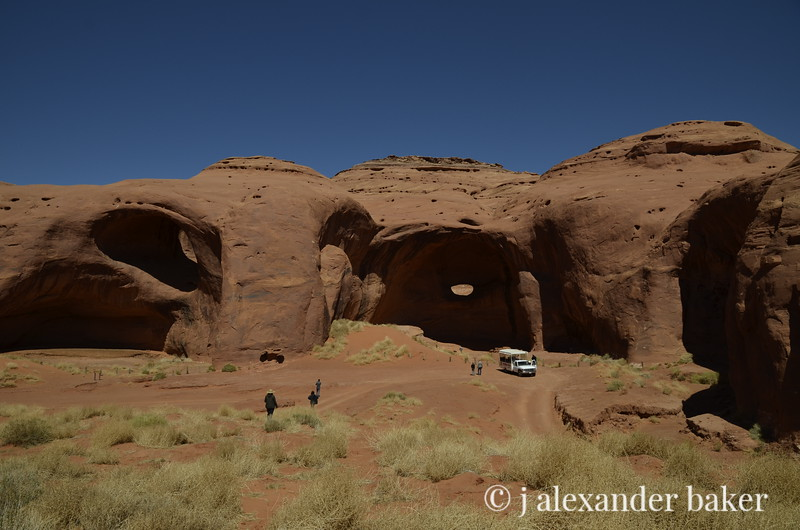 Moccasin Arch on left, Big Hogan Arch on right, Monument Valley, Navajo Nation, USA