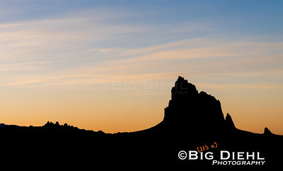 "Tsé Bit'a'i (""rock with wings"" ""winged rock""), better known as Shiprock rises from the high desert of the Four Corners.  Silhouetted against the setting sun, the outline is unmistakable."
