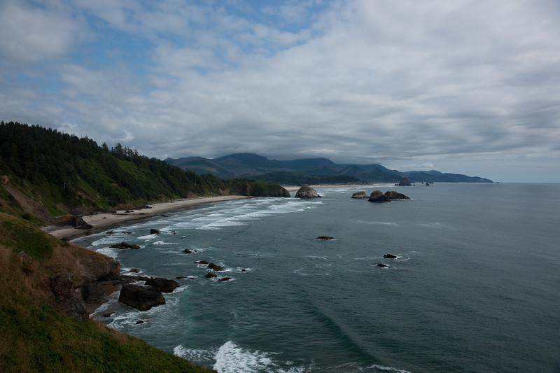 """Gorgeous view south down the coast from Ecola State Park.  The famous """"haystack"""" rock at Cannon Beach is visible in the background."""