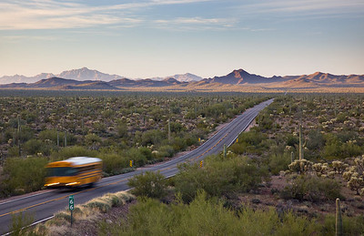 A School bus heads north from the border of Mexico and the US.