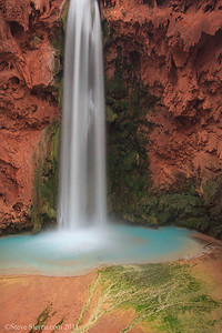 Mooney Falls is known as the mother of waterfalls.  It is located in Havasu Canyon a tributary to the Colorado River inside the Grand Canyon near the village of Supai inhabited by the Havasupai Indians.