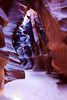 """Into The Labyrinth""<br /> <br /> This is the entrance into Upper Antelope Slot Canyon.<br /> <br /> Upper Antelope Canyon is called Tsé bighánílíní, ""the place where water runs through rocks"" by the Navajo. <br /> I went on a special 2 hour photo guided tour through the slot canyon and was overwhelmed by the amazing beauty of this magnificent place... <br /> <br /> The reason that I do photography is that it puts me there..., in the moment, witnessing some amazing natural beauty. I had a hard time focusing... being here, because it was breathtaking to be inside this Labyrinth of water carved sandstone. <br /> <br /> I was visiting to early in the season to see light beams shining from above, but my guide put me there each time a potential beam would shine down from above. He would throw sand up into the beam and the breeze would move the sand highlighting the shaft of light.<br /> <br /> In later months, this is the place to be for beams of light to enhance one's experience and photographs."