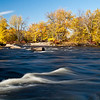 An island in the mighty Merrimack River.  When I went down the first time I knew I had to come back with a tripod.<br /> <br /> Why it's the best of 2010 - because it's a powerful subject that river and because I worked for some time on the bank trying to frame this right - particularly that stripe of rough water that leads your eye to the trees.  I must have looked funny shuffling around and peering down into my LCD screen over and over again. Longish shutter speed, but not too much that the trees are totally blurry and light that is direct, but not too flat or harsh.   Finally though, it came together.