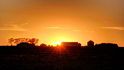 The sun sets on a farm in Potter, Nebraska.