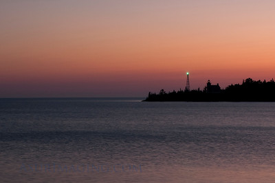 Sunrise over Copper Harbor lighthouse.