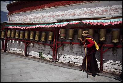 Old Lady with Prayer Wheels at the foot of Potala Palace