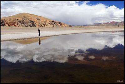 Photographer Reflection, a pond near the shore of Lake Namtso