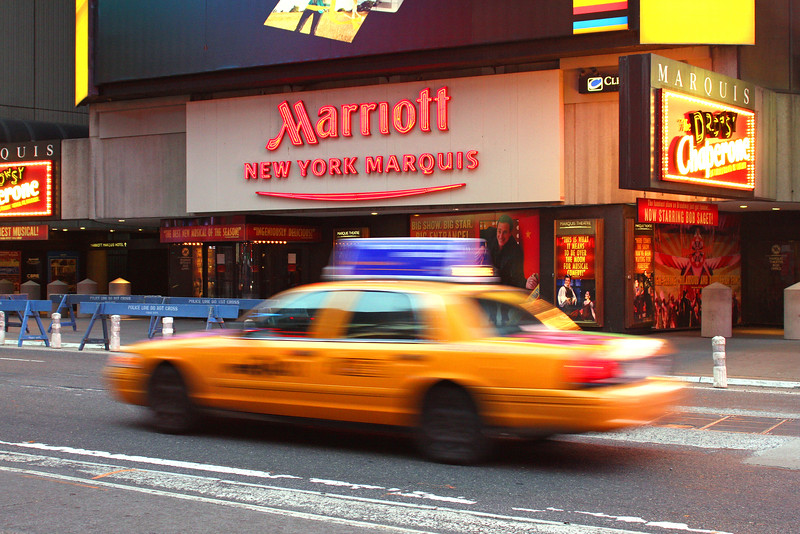 Cab passing Times Square Marriott