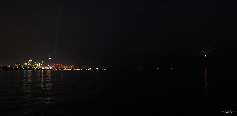 Moon rising on the right.<br /> 14mm<br /> Note how far we were away from the far shore.  Then look at the next photo.