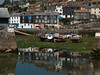 Mevagissey Harbour at low tide. Copyright Peter Drury<br /> A view through the inner harbour entrance. The day was particularly calm as the reflections from water in the outer harbour witness.