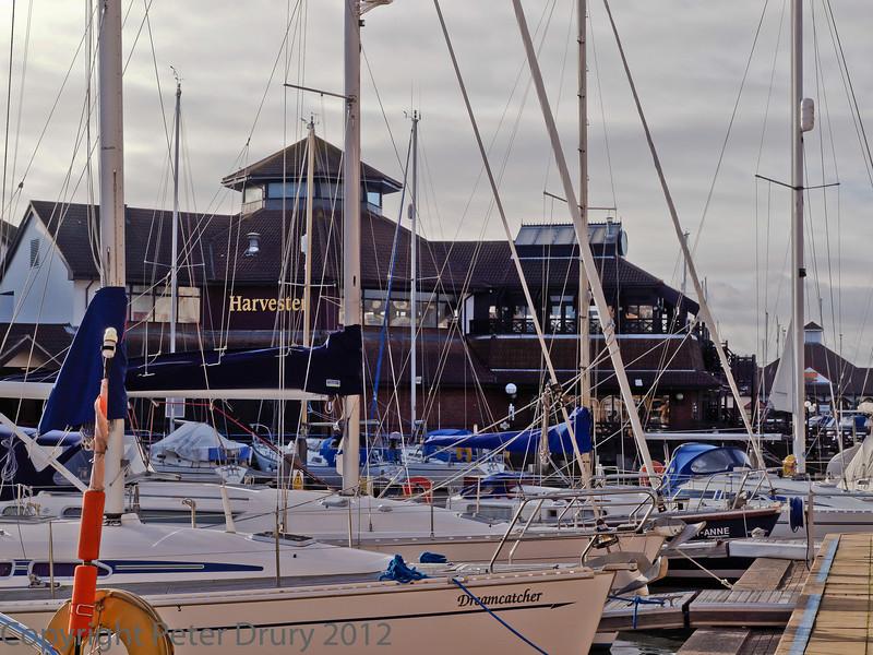 08 January 2012 Port Solent East residential block. The Harvester restaurant seen across the private moorings.