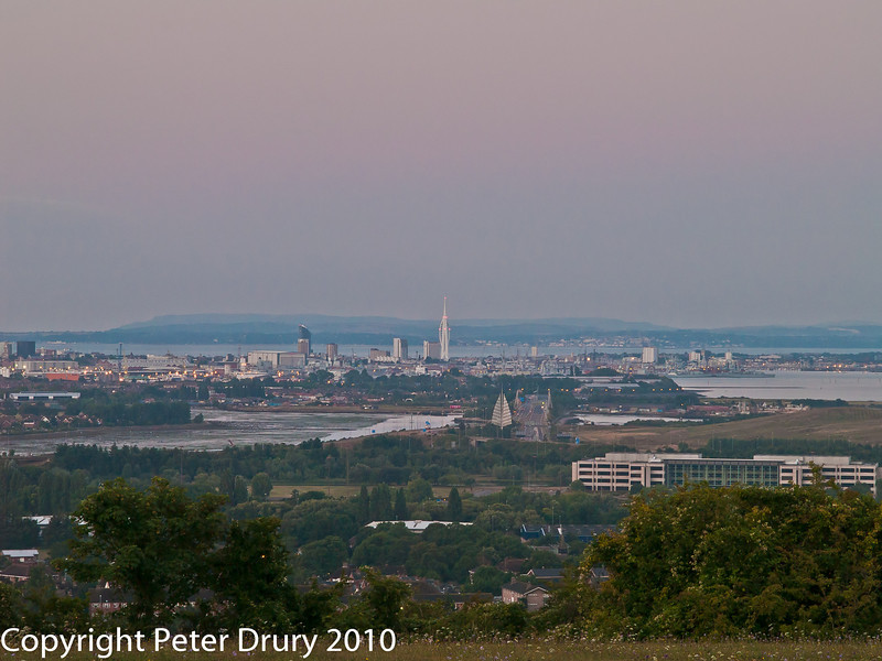 08 Aug 2010 - Early dawn over Portsmouth. Copyright Peter Drury 2010<br /> Just right of centre is the M275 with the 'Sails of the South' alongside.Spinnaker Tower is at the centre. Ryde, IOW, can be seen across the solent.