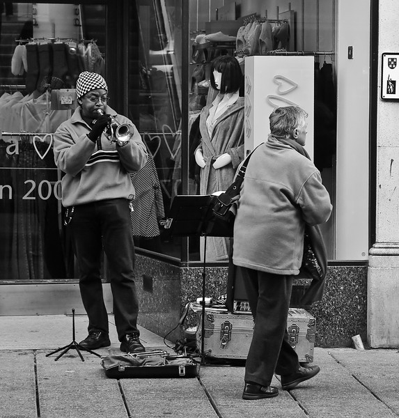 "Winchester Busker. Copyright Peter Drury 2009<br /> Converted to B&W and cropped as suggested by Richard on Dgrin - Street P&J. <a href=""http://www.dgrin.com/showthread.php?p=1225756#post1225756"">http://www.dgrin.com/showthread.php?p=1225756#post1225756</a> - Thanks Richard"