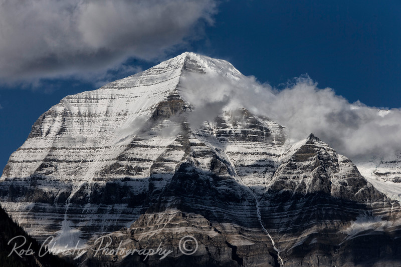 Mount Robson, British Columbia. 9843 ft at the summit. Mount Robson is the most prominent mountain in North America's Rocky Mountain range; it is also the highest point in the Canadian Rockies.<br /> RWC18216e