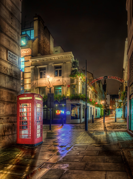 Empty Carnaby early in the morning. A London Phonebooth stands just at the gates of Carnaby. Photo by: Jacob Surland, www.caughtinpixels.com