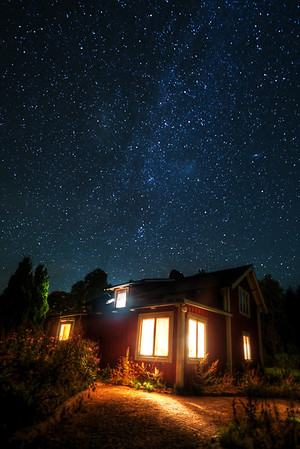 Stars above swedish cottage