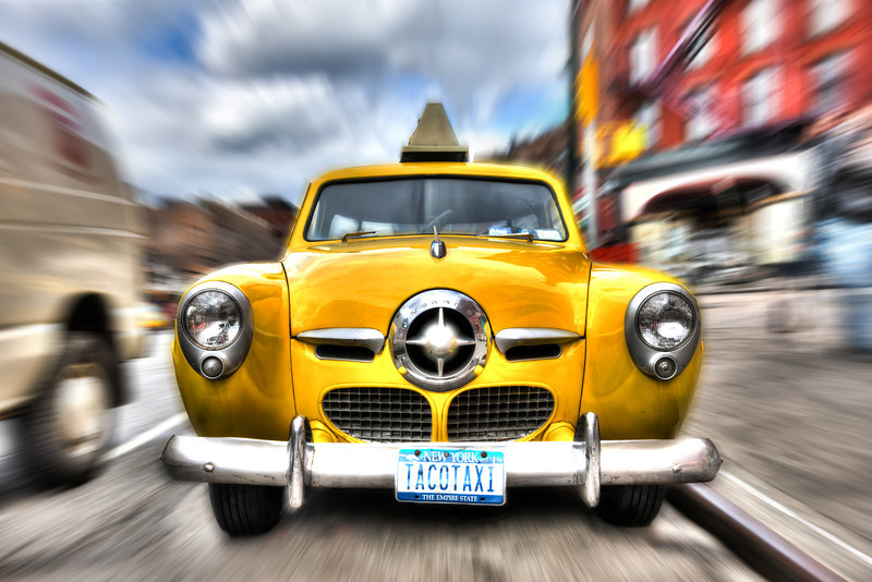 USA - New York - The ghost driver in the Taco Taxi<br /> This got to be the coolest yellow cab in New York City. Found on 7th avenue on Manhattan. A 1950 Studebaker.