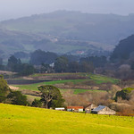 San Mateo Farm and Hills.  Another tranquil setting in San Mateo county near Pescadero.  Nestled between the hills in the spring with green grass and the barn tucked away in there.  #DSC5040