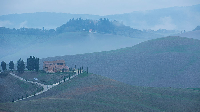 Morning mist in Asciano, Siena, Italy