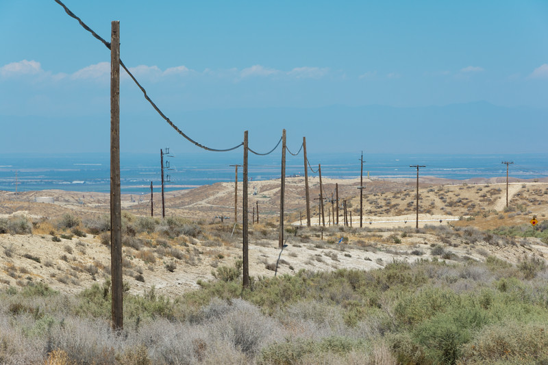 From near the McKittrick Wastewater Treatment Station looking west down towards Buttonwillow into the San Joaquin Valley. On Highway 58, west of Buttonwillow, California, USA, June 2015. [McKittrick-HWY58 2015-06 009 CA-USA]