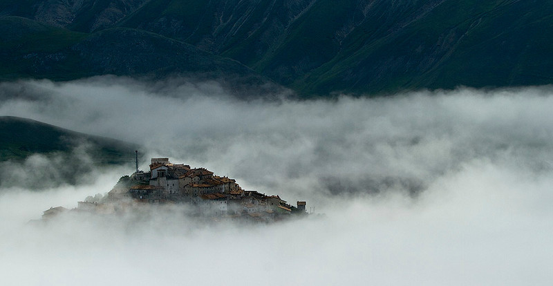 The village of Castellucio emerged briefly from the morning mist with the mountains of Monti Sibillini National Park beyond.