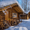 A Row Of Snowy Alaksan Cabins -Chena Hot Springs Resort, Fairbanks, Alaska