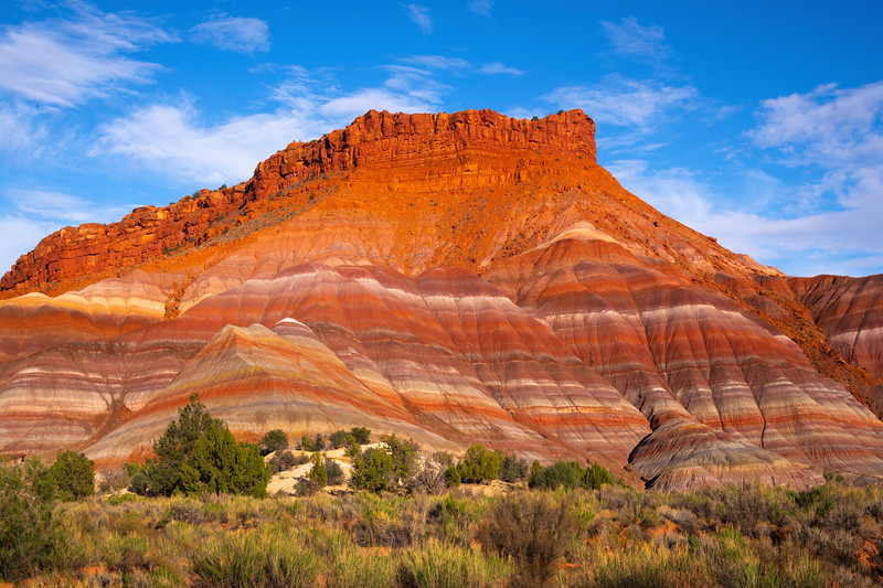 Warm Light Spreads Across The Painted Hills - Paria Ghost Town, Painted Hills, Grand Staircase-Escalante National Monument, Utah