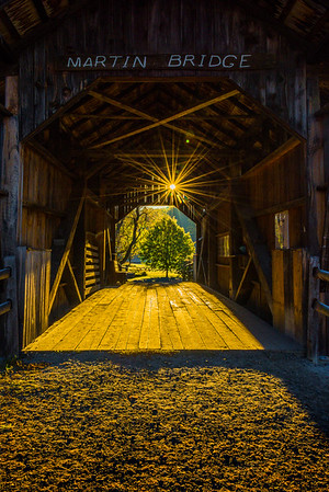 Sunstar Shining Through Covered Bridge