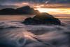 Sun Setting Behind The Sea Stacks