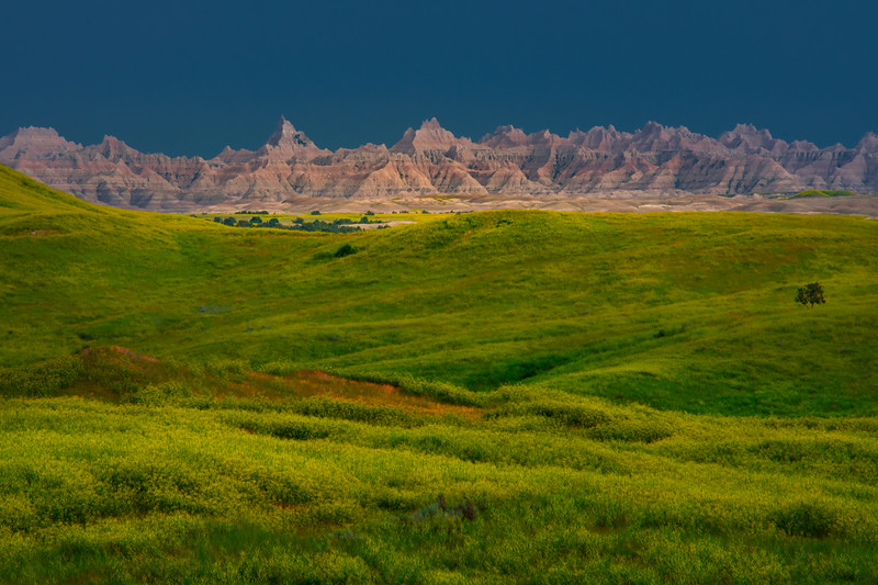 Light Shining On Badlands In Stormy Weather - Badlands National Park, South Dakota