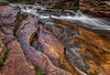 Ammonoosuc river cascading over jagged rocks