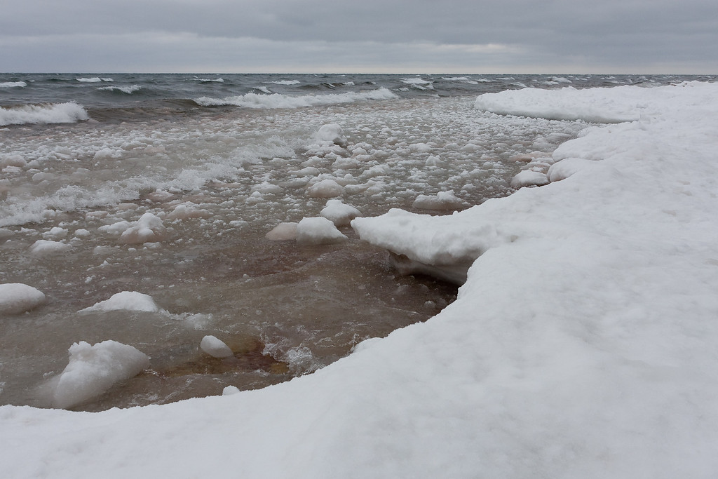 Ice builds on the shore of Lake Superior.