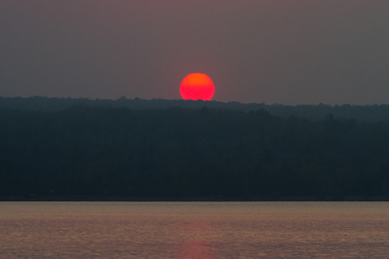 The sun appears broken just before it falls below the horizon.