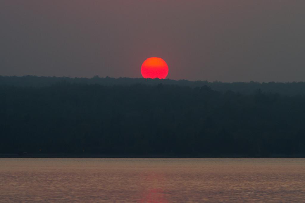 The sun appears broken just before it falls below the horizon.