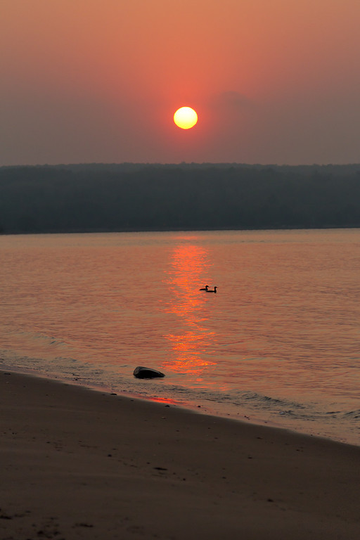 A pair of ducks during a sunset on Keweenaw Bay.
