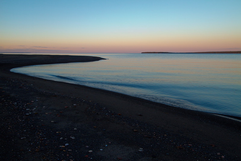 Calm water on Keweenaw Bay at dusk.